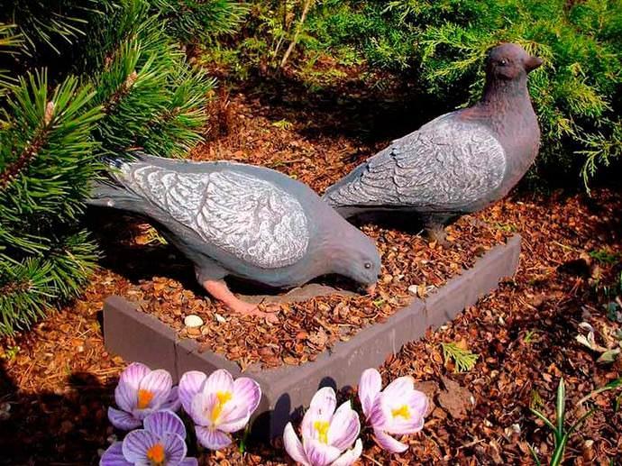 Фигурки для сада должны гармонировать с домом и окружающей территорией